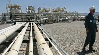 OPEC December oil output slips, still near record