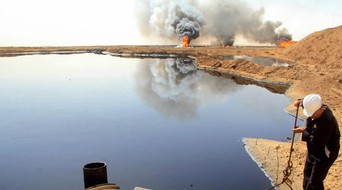 Iraq official tells oil firms not to be 'greedy'