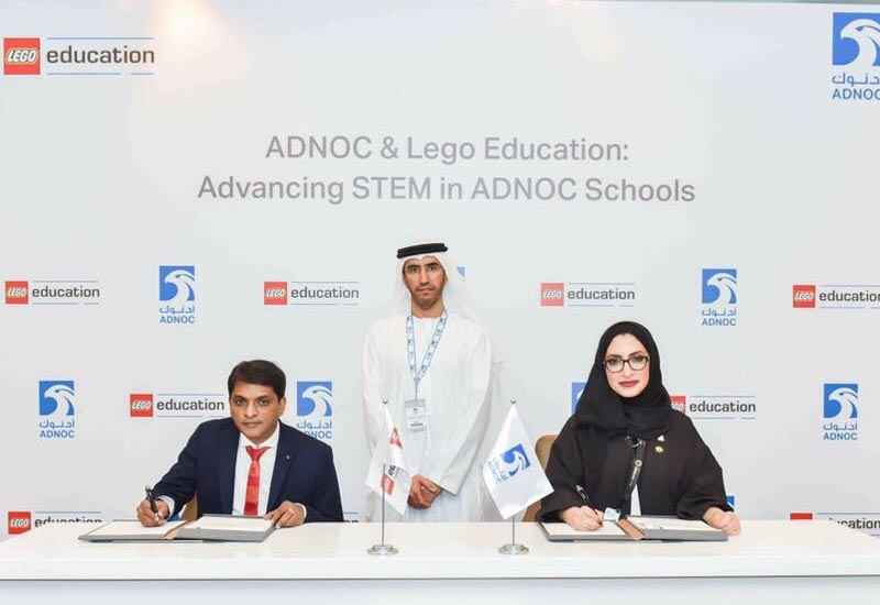 The agreement was signed at ADIPEC 2017 by Reem Al Buainain (sitting, right), manager, corporate social responsibility (CSR), ADNOC, and Senthil Kugan, director, ATLAB/Emphor Trading, on behalf of Lego Education.