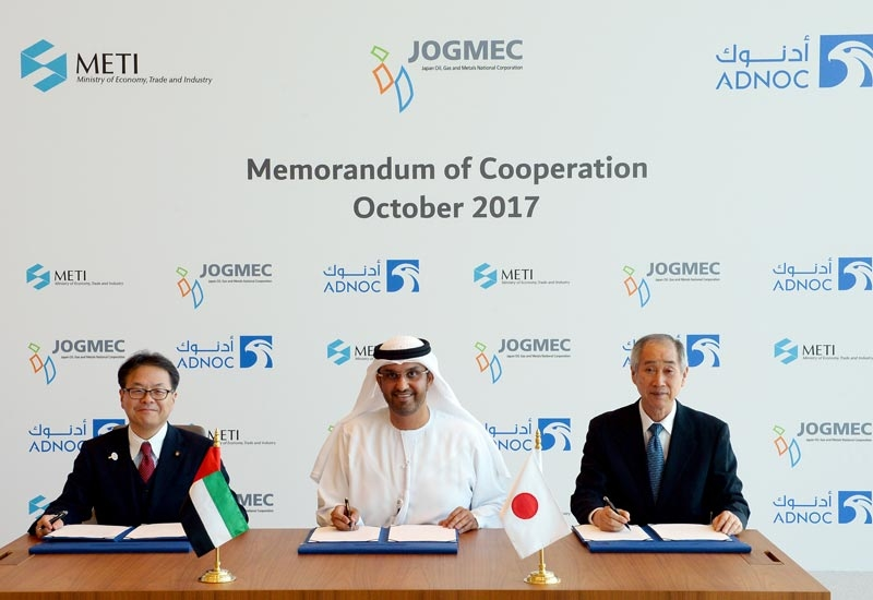 HE Dr Sultan Ahmed Al Jaber (centre), UAE minister of state and ADNOC Group CEO, signs the agreement with Hiroshige Seko (left), Japans minister of economy, trade and industry, and Keisuke Kuroki, president, Japan Oil, Gas and Metals National Company.