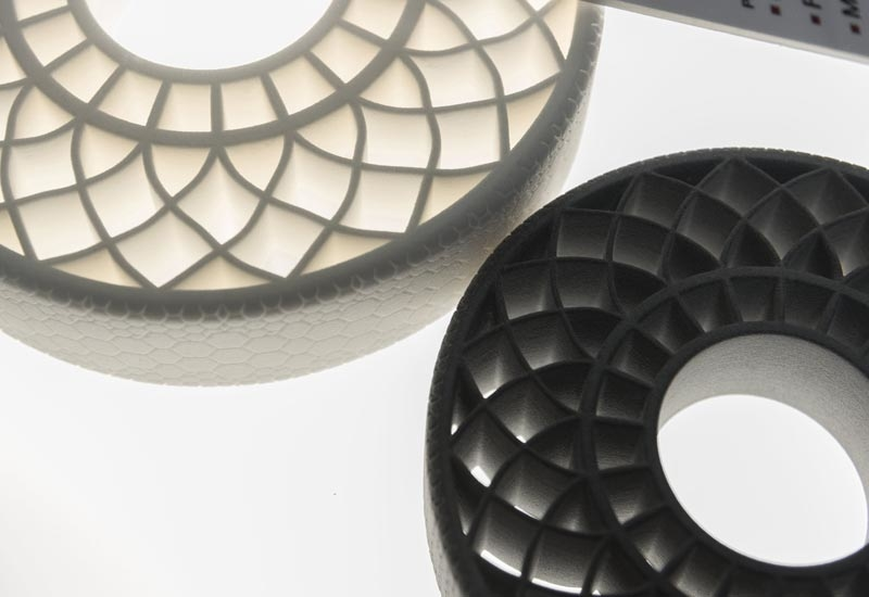 In the chemical industry, BASF has the broadest product portfolio of materials that can be developed for 3D printing. The photo shows two airless tires that were created with 3D printing technologies using thermoplastic polyurethane from BASF.