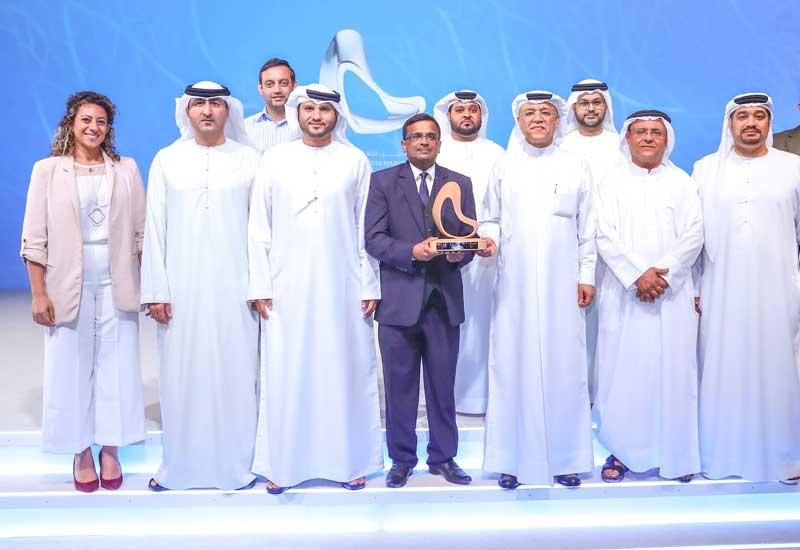 ENOC employees celebrate winning the RTA award.