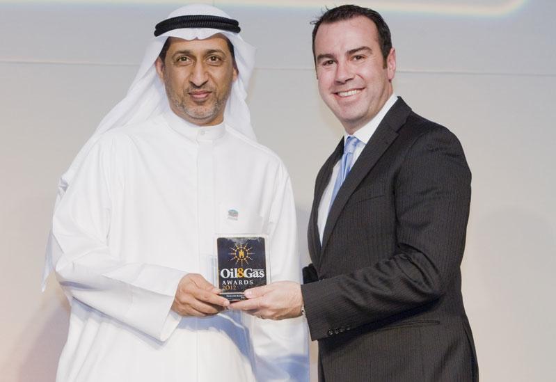 Equate's VP of Technical Services, Mohammad Al Benali, left, receives the award from Alpari chief executive, Iskandar Najjar, right.