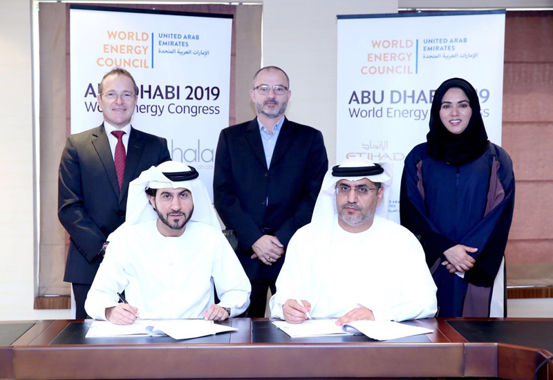The agreement was signed by HE Dr Matar Al Neyadi (sitting, right), chair of the organising committee and undersecretary of the UAE ministry of energy, and Mohammad Al Bulooki (sitting, left), executive vice president, commercial, Etihad Airways.