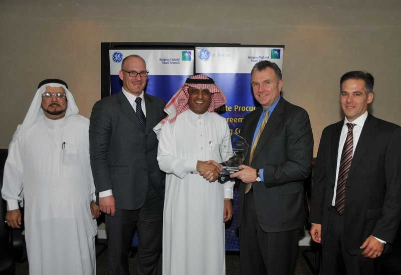 A file photo of a contract signing ceremony between GE and Saudi Aramco.