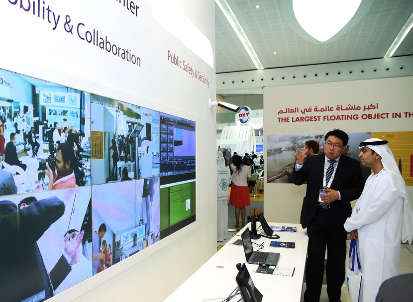 Huawei expert showcases an innovative piece of technology at the company's stand at ADIPEC.