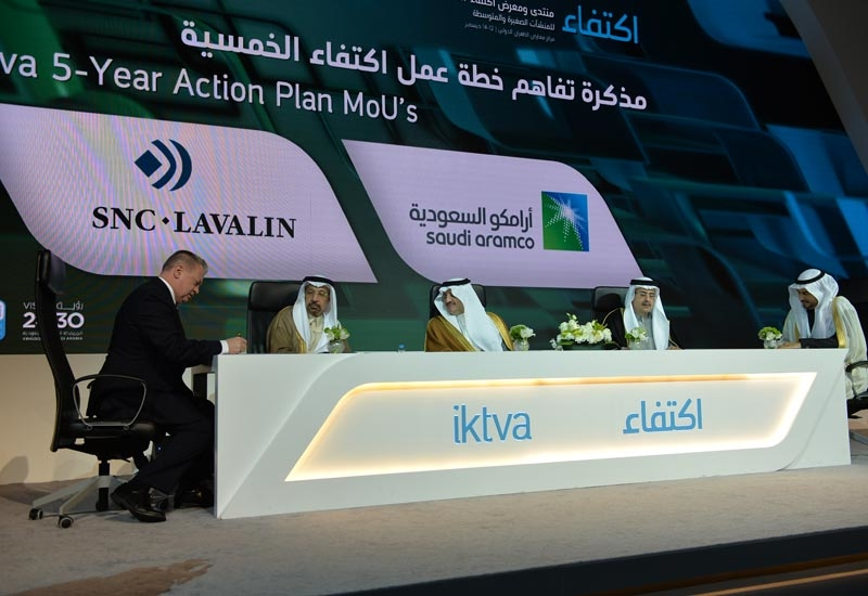 Neil Bruce (left), president and CEO, SNC-Lavalin, signs the MoU between SNC-Lavalin and Saudi Aramco, boosting the Iktva programme.