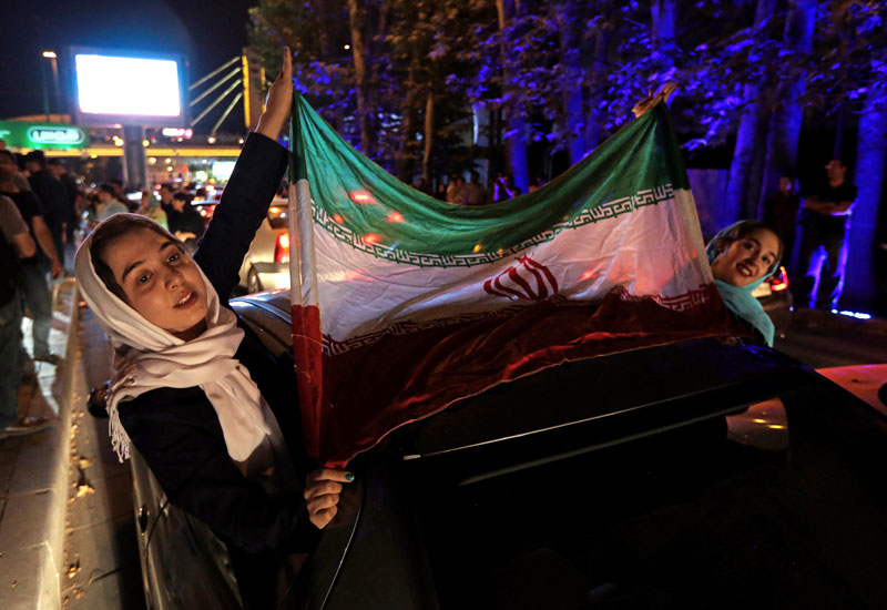 Iranians celebrate the removal of sanctions on the Islamic Republic, in Tehran in January.