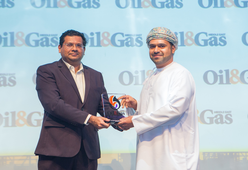 Mazen Al Ansari (right) of Orpic collects the trophy from Vinodkumar Raghothamarao, one of the Awards' judges in Abu Dhabi on October 5th.