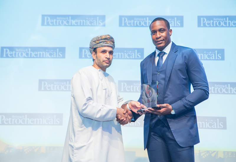 Derrick Best (right), sales executive at Oil & Gas Middle East hands over the trophy to Said Amur Al-Abri of PDO.