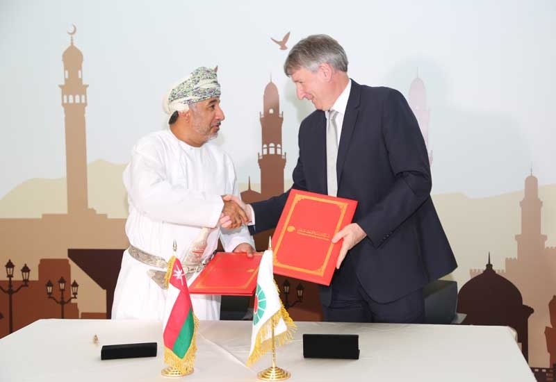 Raoul Restucci (right), managing director, PDO, after the signing ceremony of the company's social investment projects.