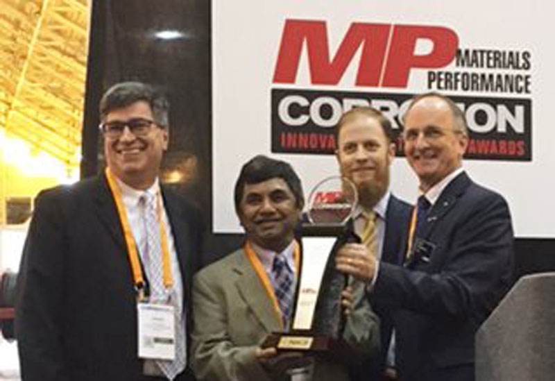 The three-member development team for Amercoat One coating – from left, Jim McCarthy, Kam Sheth and David Curran – accepted the Corrosion Innovation of the Year Award from NACE International President Sandy Williamson (far right) on March 27.