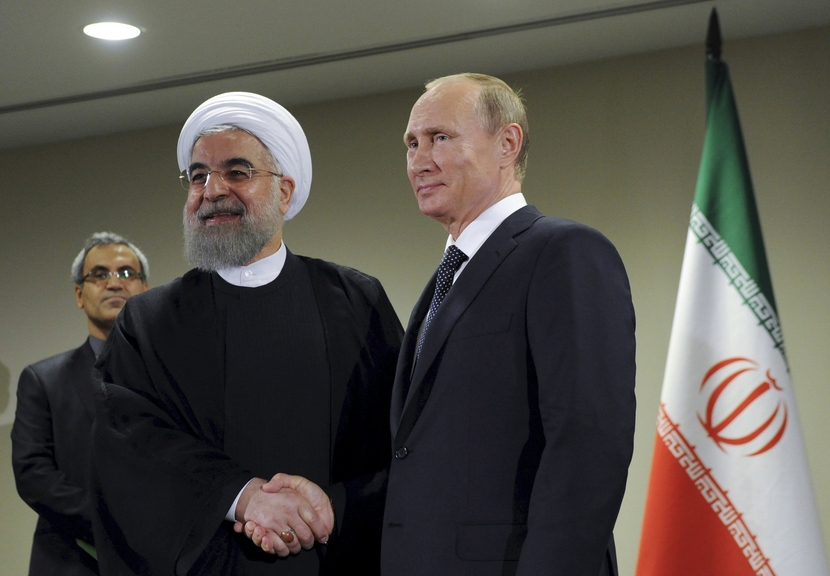 A file photo of Russian President Vladimir Putin with Iranian President Hassan Rouhani.