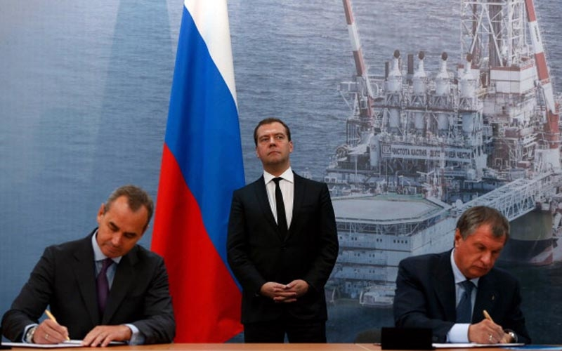 Russian prime minister Medvedev at a signing of an oil deal.