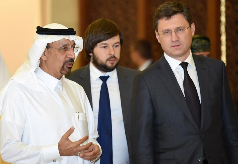 HE Khalid Al-Falih (left), minister of energy, industry, and mineral resources, Saudi Arabia, and chairman, Saudi Aramco, walks alongside Alexander Novak (right), Russian energy minister, during their meeting in Riyadh, Saudi Arabia, on 23 October 2016. (Image courtesy: FAYEZ NURELDINE/AFP/Getty Images)