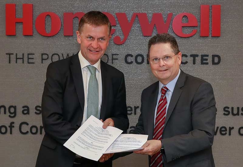 Erik Solheim (left), executive director, UN Environment, and Norm Gilsdorf, president, Honeywell High Growth Regions, Middle East, Russia, Turkey, and Central Asia, after signing the MoU at Honeywells regional headquarters in Dubai.