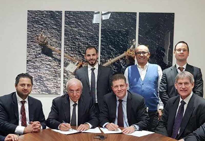 Representatives from the KRG, Crescent Petroleum and Dana Gas sign the agreement.
