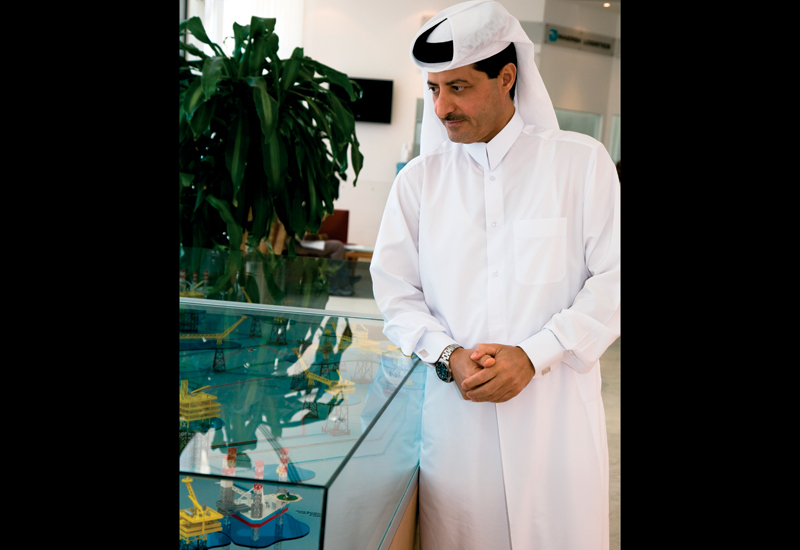 Saad Al-Mohannadi surveys a scale model of the 2005 FDP expansion project.