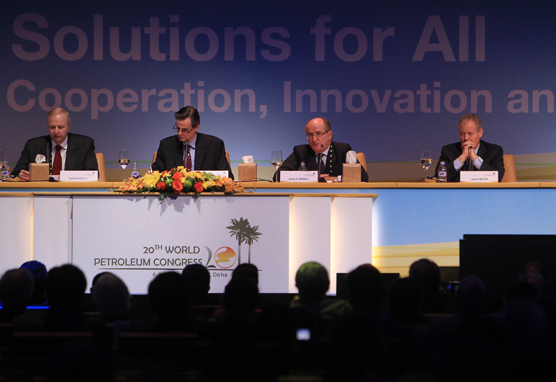 BP CEO Bob Dudley (L), Serge Dupont, Canada's Deputy Minister of Natural Resources (2L), Repsol Chairman Antonio Brufau (2R), and ConocoPhillips CEO a