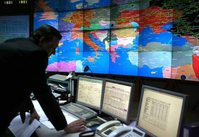 A Russian Gazprom employee works at the central control room of the Gazprom headquarters in Moscow. (GETTY IMAGES)