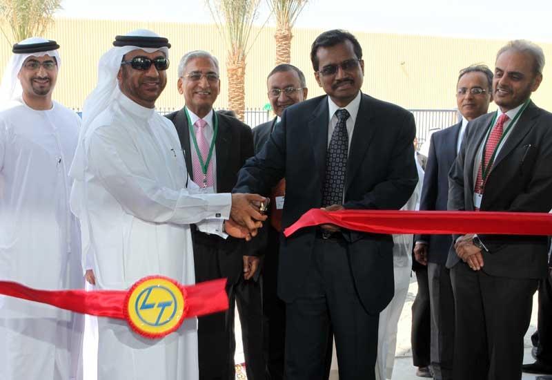 (L-R) Ibrahim Al Janahi, deputy CEO, Jebel Ali Free Zone Area and Indian Ambassador to the UAE, M. K. Lokesh open the new L&T facility.