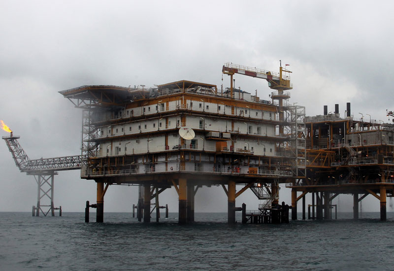 Iran's oil production drops 500,000 bpd in 2011 as foreign investors sta away. GETTY IMAGES
