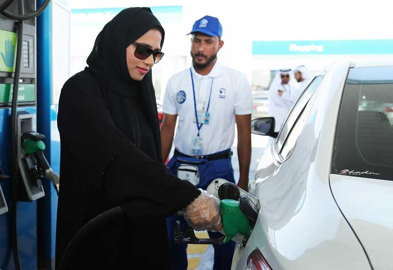 An Emirati woman chooses the self-service option at an ADNOC service station.