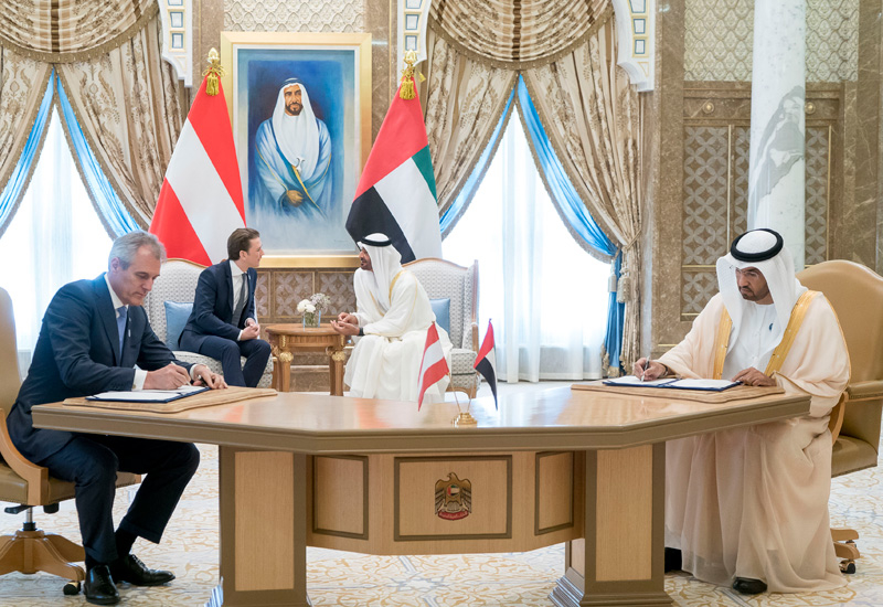 Dr Sultan Ahmed Al Jaber, ADNOC Group CEO (front right), and Dr Rainer Seele, CEO of OMV, sign the deal as Sheikh Mohamed bin Zayed Al Nahyan, Crown Prince of Abu Dhabi (back right), and Sebastian Kurz, Chancellor of Austria, look on.