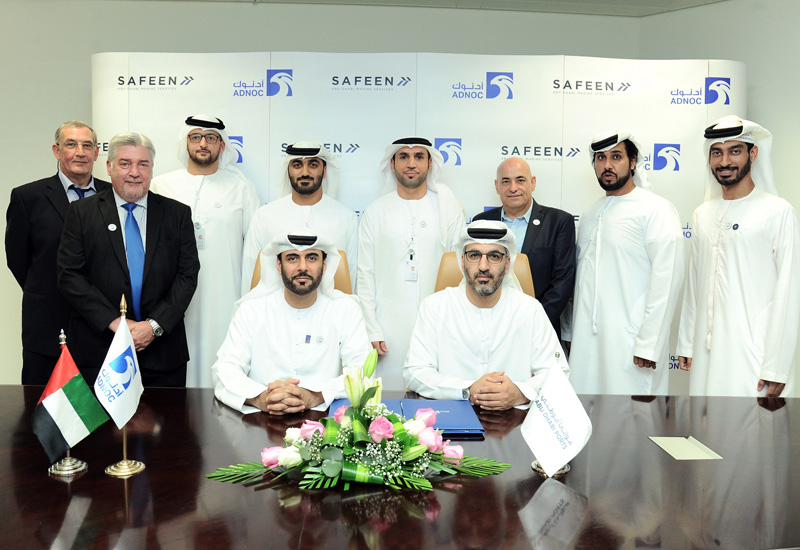 The signing ceremony between SAFEEN and ADNOC Logistics & Services in Abu Dhabi.