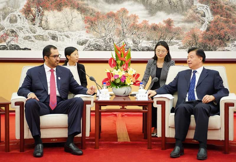 Dr Sultan Ahmed Al Jaber (left), UAE minister of state and ADNOC Group CEO, meets with Wang Yilin, Chairman of China National Petroleum Corporation.