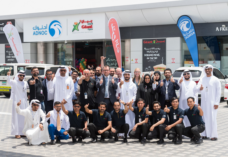 An ADNOC and Geant group photograph.