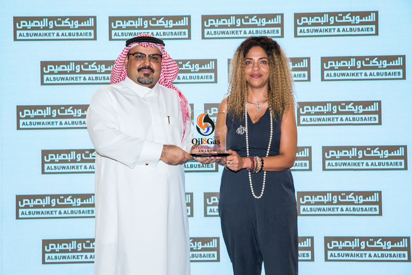 Hanan Darwish, then president of the Gulf and Pakistan for Schneider Electric, accepting the award for Oilfield Services Company of the Year at the 2018 edition of the event