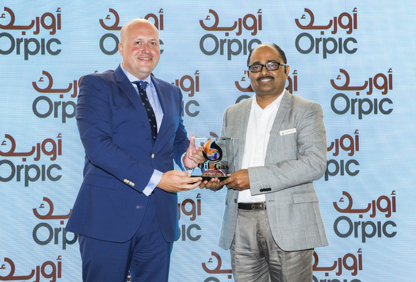 Shivananda Baikady (right), general manager for road transport and warehousing, Tristar Group, receives the 2018 'Logistics Provider of the Year' Award, won by Tristar Transport, from Andres Suarez, general manager, logistics, at Orpic.