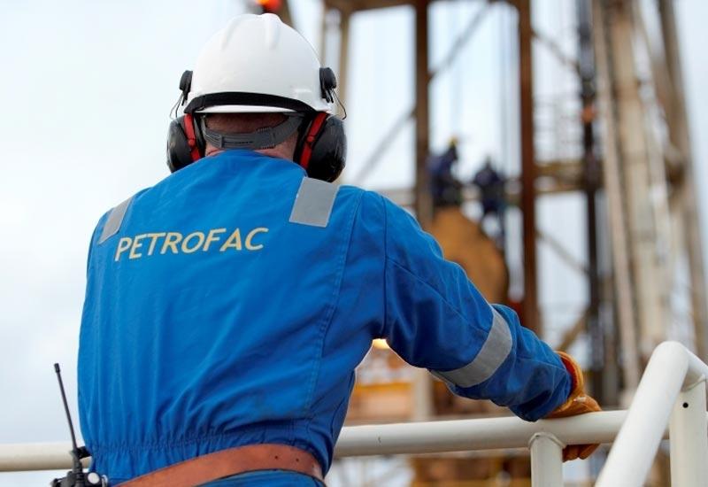 A Petrofac employee works in the field.