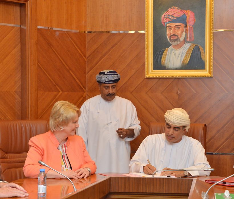 Occidental President and CEO Vicki Hollub signs an exploration and production sharing agreement with Oman Oil and Gas Minister Dr. Mohammed bin Hamad Al Rumhy