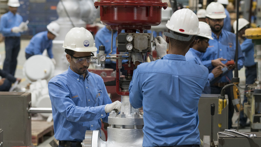Workers at BHGE's KSA valve manufacturing plant