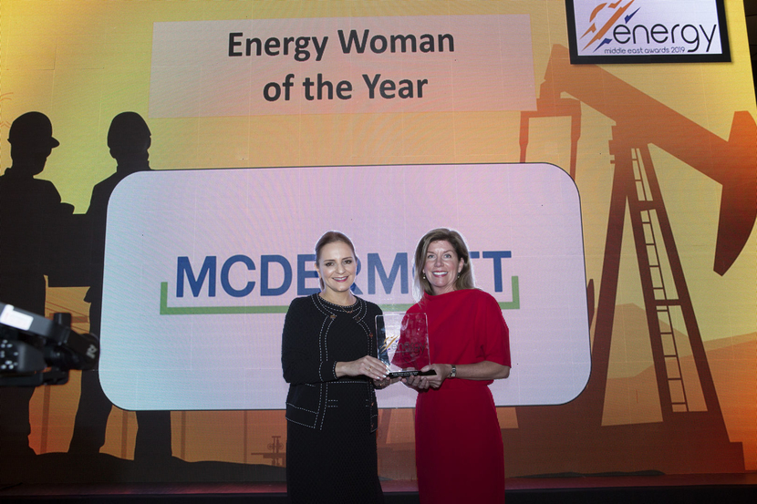 Barbara Knight (right), senior director, area communications and marketing, McDermott, presents the Energy Woman of the Year Award to Nadia Bader Al-Hajji, deputy CEO, projects and business development, Petrochemical Industries Company, at the 2019 Middle East Energy Awards.