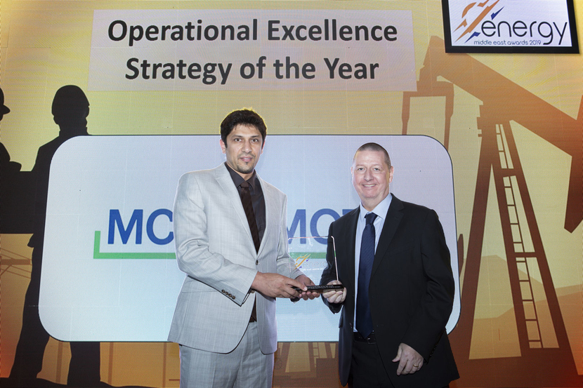 Abdulaziz Ali Najaf (left), team leader, artificial lift S&EK/WK, well surveillance group, Kuwait Oil Company, receives the Operational Excellence Strategy of the Year Award won by Kuwait Oil Company for the Integrated Creative Programme for Sustainable Oil Production from Guy McLear, head of HSES, McDermott, at the 2019 Middle East Energy Awards.