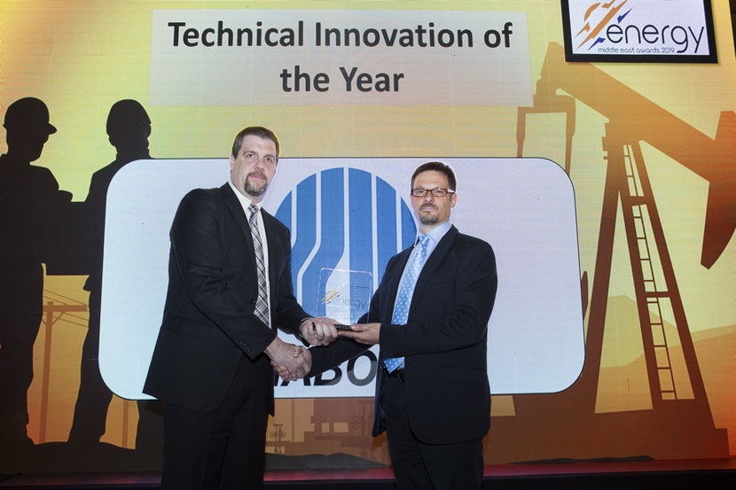 Mike Affleck (right), senior petroleum engineer – EXPEC ARC, drilling technology team, Saudi Aramco, receives the Technical Innovation of the Year Award won by Saudi Aramco for Auto Well Space Out from Michael Niedermaier, vice president, operations, Nabors Drilling International Gulf, at the 2019 Middle East Energy Awards.