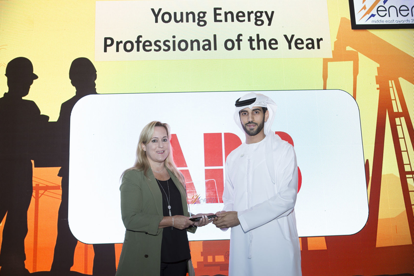 Helal Suhail Al Mazrouei (right), petrochemicals analyst, Mubadala Investment Company, receives the Young Energy Professional of the Year Award from Birgit Gross, HR Manager, ABB, at the 2019 Middle East Energy Awards.