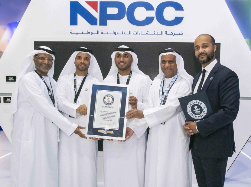 Aqeel Abdulla Madhi, vice chairman of NPCC, and Eng. Ahmed Al Dhaheri, CEO of NPCC, accepting the Guinness World Recordsd™ title for 'The heaviest single-module topside on a fixed steel jacket' at NPCC's pavilion at ADIPEC 2019.