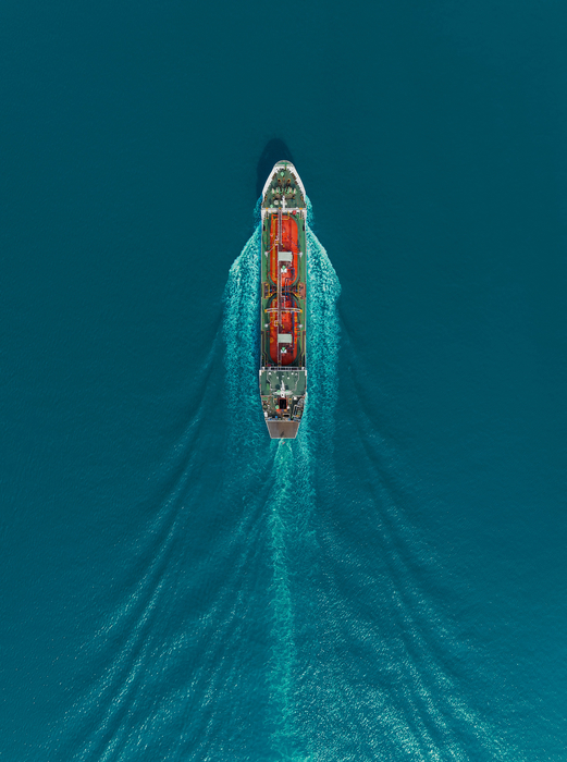 Aerial top view Oil ship tanker carier oil from refinery on the sea